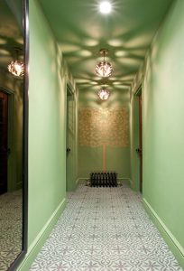 soften strong stone walls with lush garden greens historic stately hallway shalini misra