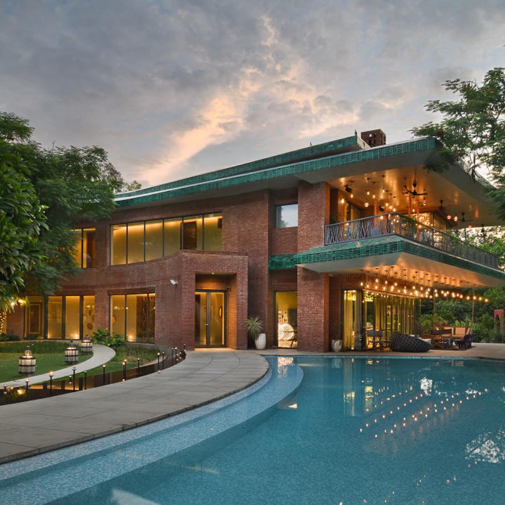 delhi family retreat farm house design swimming pool