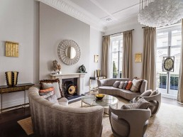 eaton place design beige sofas and coffee table