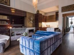 eaton place design blue sofa in living room