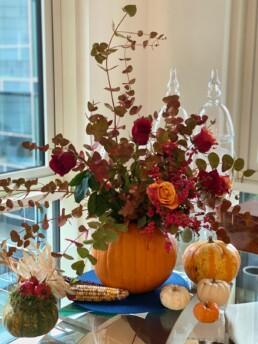pumpkin vase full of flowers