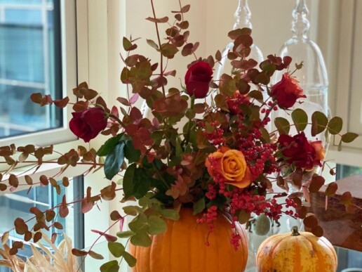 pumpkin vase full of flowers