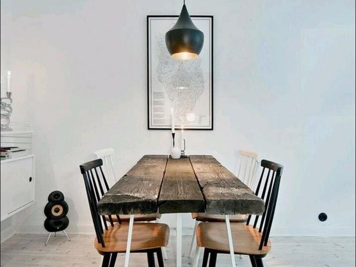 tom dixon pendant light above dining table