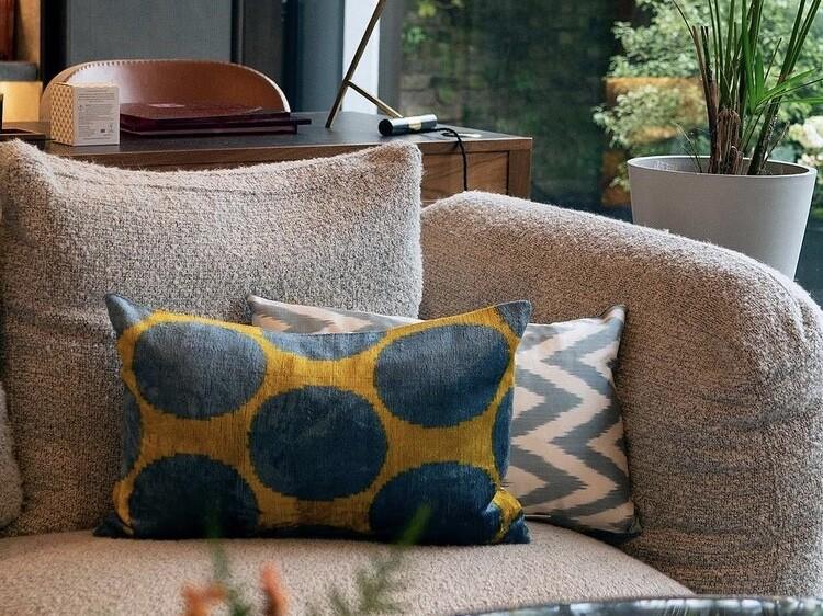 chic sofa in subtle grey & illuminating yellow cushions