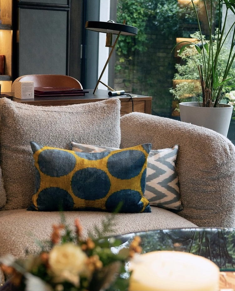 chic sofa in subtle grey & illuminating yellow cushions