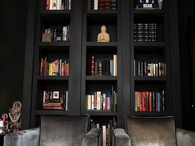 deep rich charcoal painted bookshelves