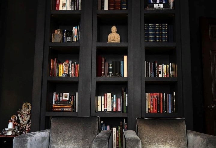 deep rich charcoal painted bookshelves